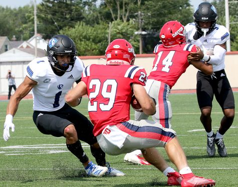 Eastern safety Jordan Vincent (1) prepares to make attempt a tackle on a Dayton ball carrier in a game on Sept. 11. Vincent had 12 total tackles in the game, which Eastern lost 17-10.