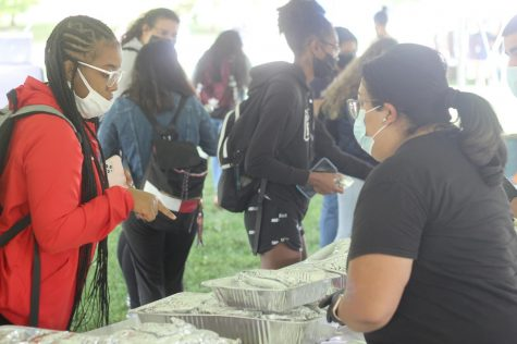 Brejona Hutchinson, a sophomore majoring in computer and information technology, enjoys Latino Heritage Kickoff by waiting in line for a taco.