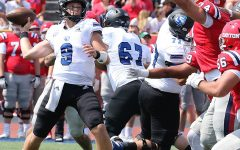 Eastern quarterback Chris Katrenick releases a pass while the Dayton pass rush bears down on him in a game Sept. 11. Katrenick was 12-for-27 passing for 111 yards in the game, which Eastern lost 17-10.