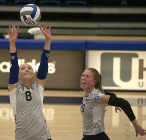 Eastern setter Summer Smith (8) sets the ball up for middle blocker Emily WIlcox in a match against Northern Illinois Sept. 2 in Lantz Arena. Smith had 30 assists and Wilcox had 8 kills in the match, which Eastern won 3-1.