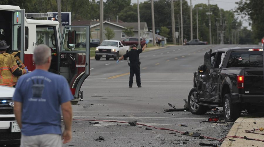 Scott Smith, Charleston, Ill. city manager observes the damages of the five-car accident at the intersection of University Drive and Lincoln Avenue Sunday afternoon.