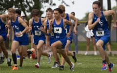 The Eastern mens cross country team races from the starting line to begin the EIU Walt Crawford Open at the Tom Woodall Panther Trail on Sept. 3. Both the mens and womens team placed first in the open.