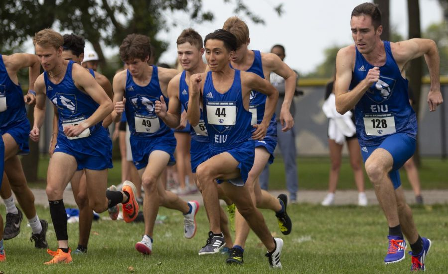 The Eastern men's cross country team races from the starting line to begin the EIU Walt Crawford Open at the Tom Woodall Panther Trail on Sept. 3. Both the men's and women's team placed first in the open.