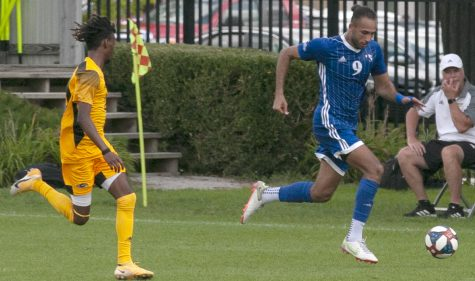 Eastern forward Shady Omar dribbles the ball up the sideline in a match against Milwaukee on Aug. 30 at Lakeside Field. The match was canceled at halftime due to severe weather.