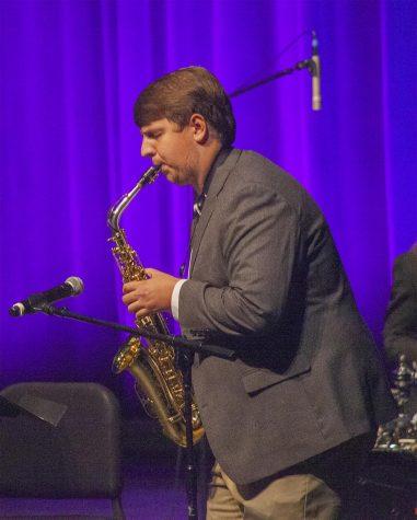 Austin Spillman, a senior music education major, plays the alto saxophone during a duet at the Jazz Concert Thursday night.