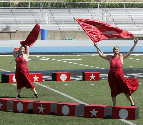 """The Richland County High School Marching Tigers color guard perform as part of """"The Greatest Show."""" It featured songs from """"The Greatest Showman,"""" and props that evoked a circus theme. The show opened with band and color guard members pantomiming a circus and audience. They placed fourth in the 3A division."""