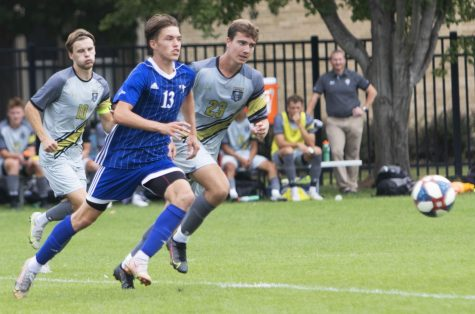 Eastern midfielder Chad Hamler races a pair of opponents to the ball in a match against Purdue Fort Wayne on Sept. 7 at Lakeside Field. Hamler had a shot in the game, which Eastern lost 1-0.