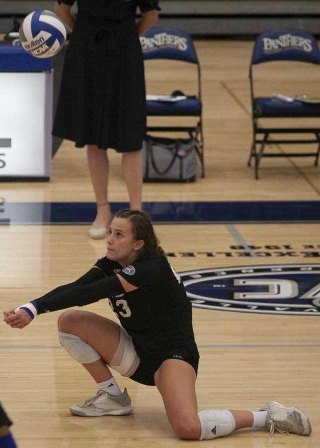 Eastern outside Kylie Michael drops to a knee to receive a serve in a match against Indiana State on Sept. 19 in Lantz Arena. Michael had 8 kills in the match, which Eastern lost 3-1.