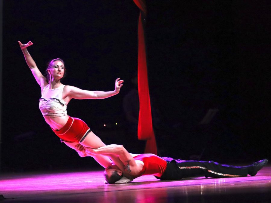 Ellen Waylonis, a circus artist, performs partner acrobatics, aerial rope, and ensemble along with Roger May who performs contact juggling, partner acrobatics, and ensemble in the Dvorak Concert Hall inside the Doudna Fine Arts Center.
