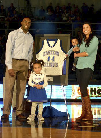 Former Eastern player Henry Domercant poses with his family on the court in Lantz Arena during his number retirement ceremony on Feb. 16, 2013.