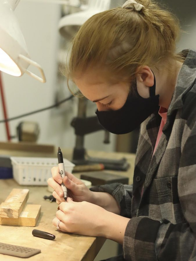 Megan Miller, a senior art education major, creates jewelry for one of her projects.