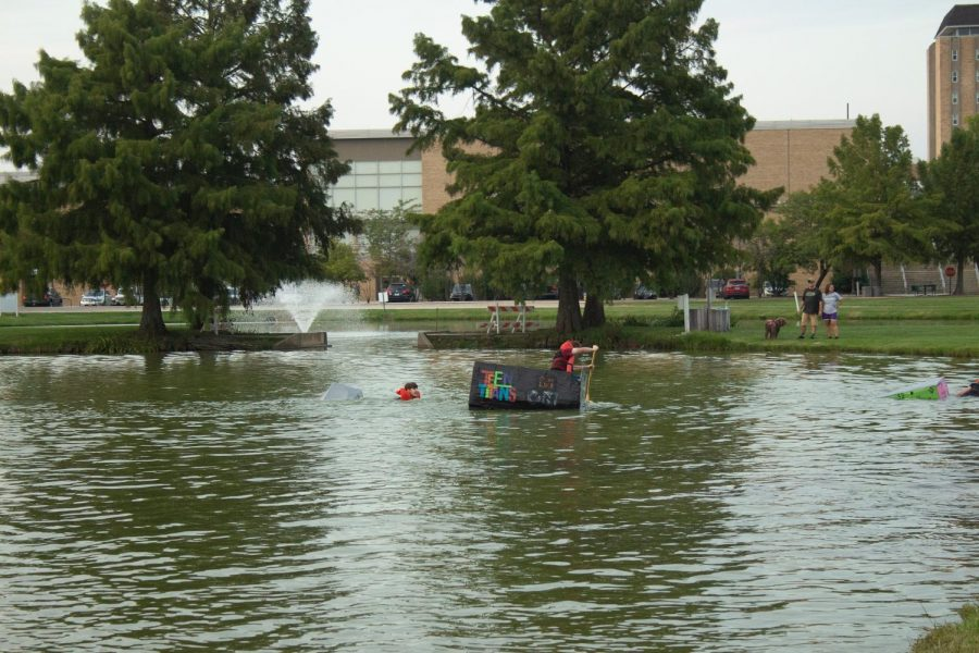 Multiple residence halls build a boat which is designed with a 2000's cartoon as the theme in order to compete in the relay race.