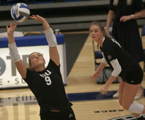 Eastern setter Bailey Chandler (left) sets the ball behind her for outside hitter Kaitlyn Flynn in a match against Indiana State on Sept. 19 in Lantz Arena. Eastern lost the match 3-1.