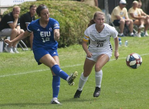 Eastern midfielder Ava Hensley swings the ball back toward the middle of the field in a match against Illinois Springfield on Aug. 22 at Lakeside Field. Eastern won the match 3-0.