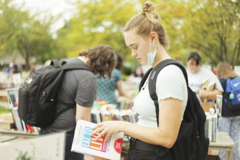 Lynsey Steffen, a senior biological sciences major, attends the Booth Library book sale that's under the clock tower.