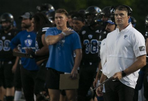 Eastern head coach Adam Cushing (right) watches his offense from the sidelines in a game against Illinois State on Sept. 18 at OBrien Field. Eastern lost the game 31-24.