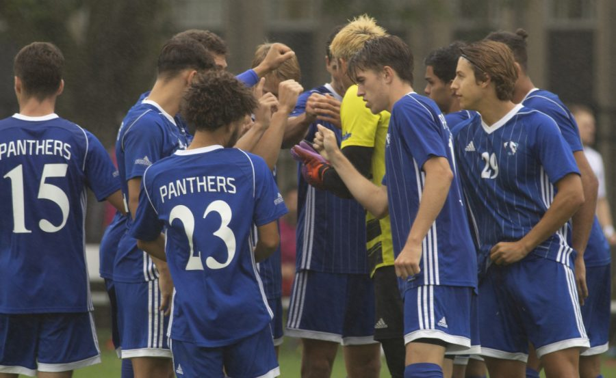The Eastern mens soccer team huddles before taking the field for the second half against Green Bay Tuesday at Lakeside Field. The Panthers and Phoenix played to a 1-1 tie.