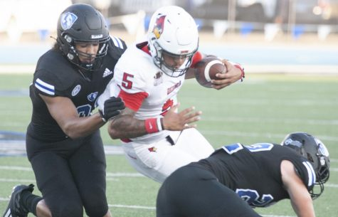 Eastern defensive end Jordan Miles tackles Illinois State quarterback Bryce Jefferson in a game against the Redbirds on Sept. 18 at OBrien Field. Miles had 5 total tackles in the game, an 31-24 loss for the Panthers.