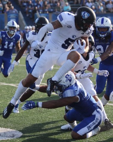 Ashanti Thomas | The Daily Eastern News Eastern wide receiver Matt Judd attempts to hurdle a tackler during a kick return against Indiana State on Aug. 28 in Terre Haute. Judd returned two kickoffs in the game for 33 yards and a long of 20 yards. Eastern lost the game 26-21.