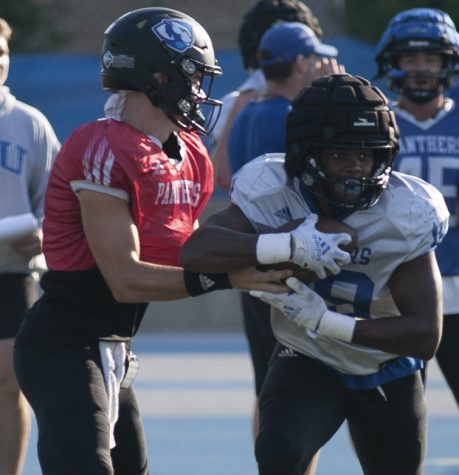 Eastern quarterback Otto Kuhns hands the ball to running back Kendi Young during practice on Sept. 27 at OBrien Field. Young had 28 yards on 5 carries in the Panthers 22-6 loss to Murray State on Saturday.