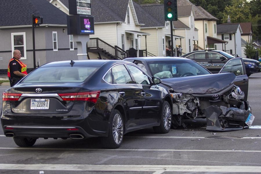 A member of the Charleston Police Department directs traffic at the two-car accident at the intersection of Lincoln Avenue and Ninth Street Monday evening.