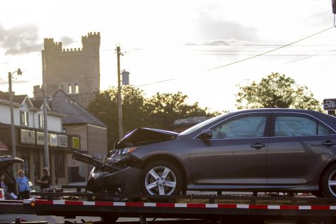 One of the cars involved in the two-car accident at Lincoln Avenue and Ninth Street sits on the back of the tow truck Monday evening.