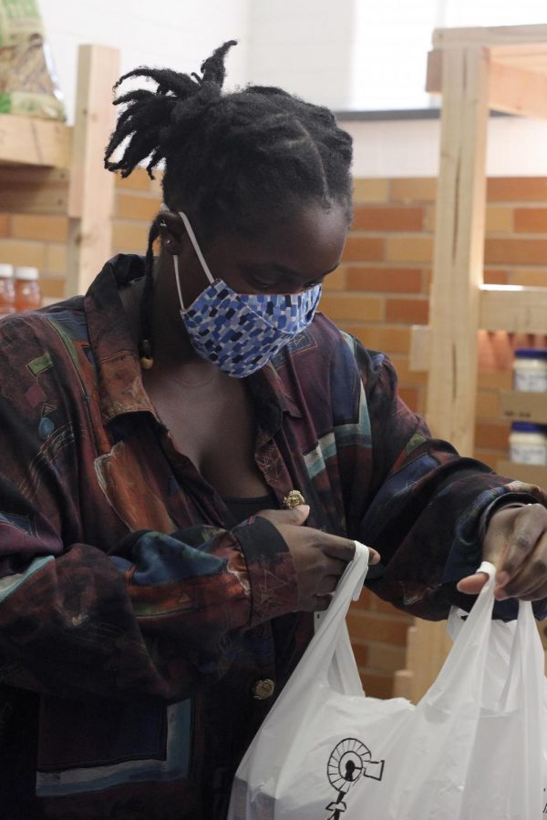 Yolanda Lejuste, a graduate student studying dietetics and nutrition, packs bags full of the food pantry staple items for students.