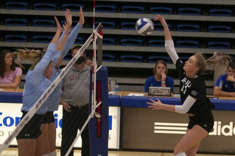 Eastern outside hitter Kaitlyn Flynn follows through on a kill attempt in a match against Indiana State on Sept. 19 in Lantz Arena. Flynn had 10 kills in the match, which Eastern lost 3-1.