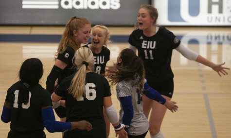 Members of the Eastern volleyball team celebrate after scoring a point in a match against Indiana State on Sept. 19 in Lantz Arena. The Panthers lost the match 3-1.