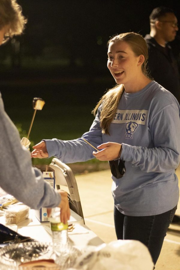 Anna Sipes, a junior biological sciences and world languages and cultures major, makes smores during La Fogata: Bonfire Stories Tuesday night.