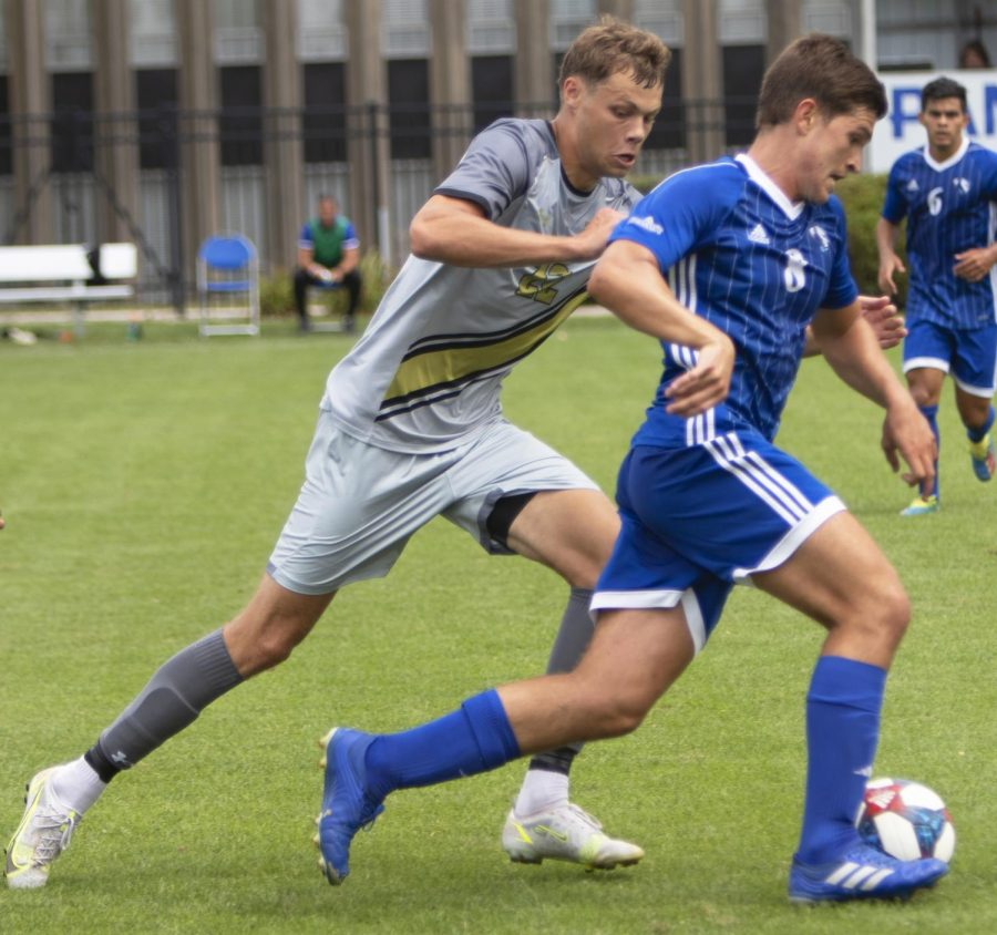 Eastern midfielder Alejandro Lurbe runs by an opponent in a match against Purdue Fort Wayne on Sept. 3 at Lakeside Field. Eastern lost the match 1-0.