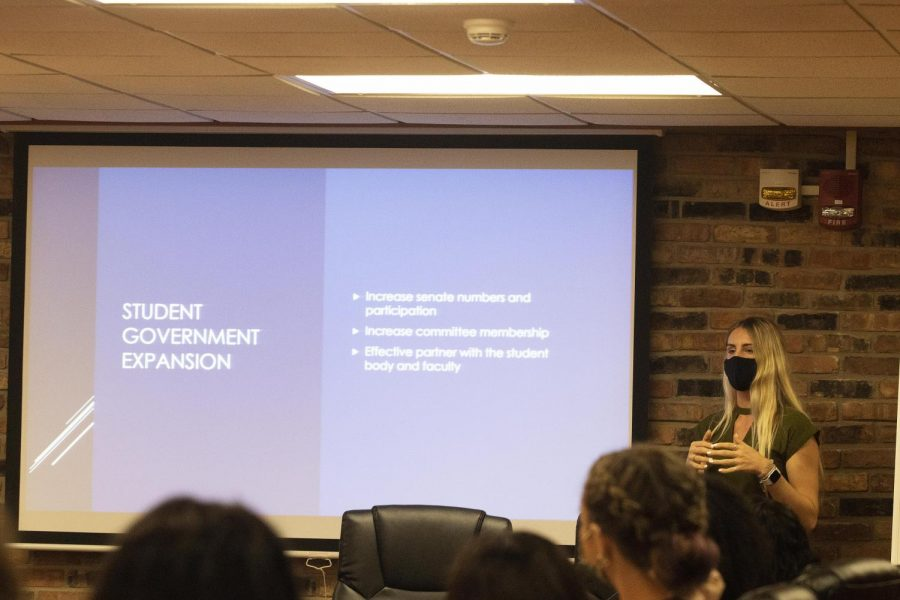 Katelynn Alexander, a senior political science major and student senator, presents her powerpoint presentation during the Student Government meeting Wednesday night.