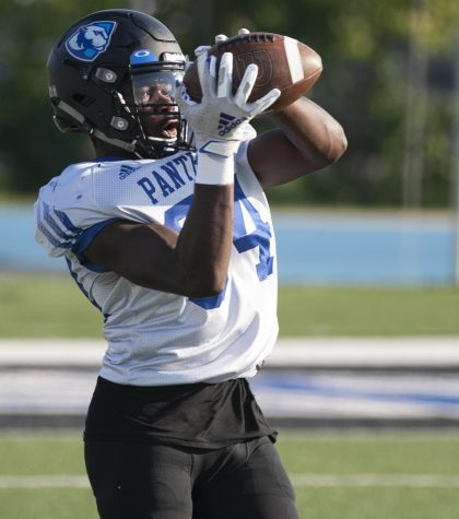 Eastern wide receiver Ryan James catches a pass during a drill in practice on Sept. 29 at OBrien Field.