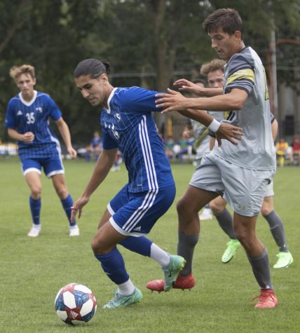 Eastern midfielder Munir Sherali keeps the ball away from an opponent in a match against Purdue Fort Wayne on Sept. 3 at Lakeside Field. Eastern lost the match 1-0.