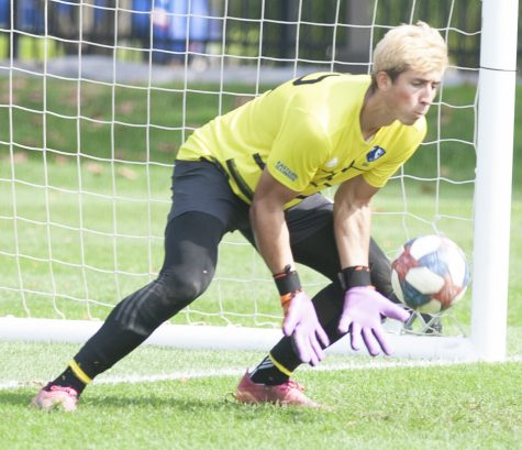 Eastern goalkeeper Jonathan Burke reaches down to make a save in a match against Omaha Saturday at Lakeside Field. Burke had a season-high 11 saves in the match, but Eastern lost 2-1.