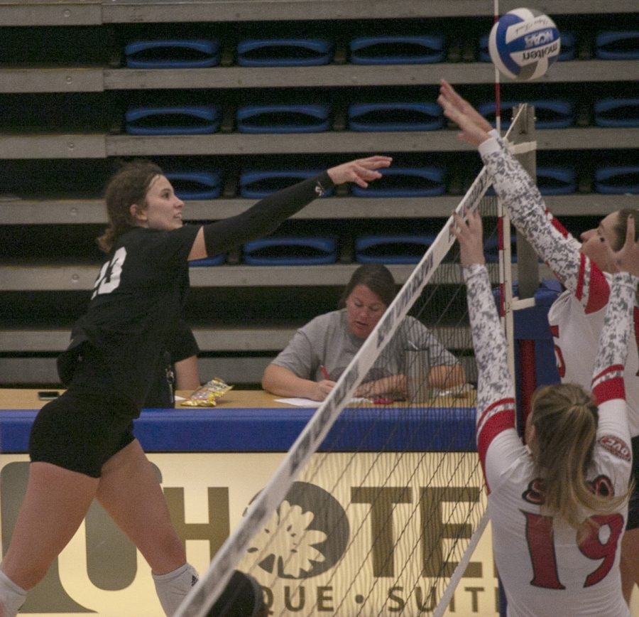 Eastern+outside+hitter+Kylie+Michael+pushes+the+ball+over+the+net+in+a+match+against+Southeast+Missouri+on+Oct.+9+in+Lantz+Arena.+Michael+had+7+kills+in+the+match%2C+which+Eastern+lost+3-0.+