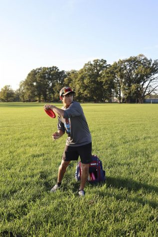 Tyler Warner, a freshman graphic design major, practices his craft, playing frisbee, during his free time and enjoys the nice weather outside.
