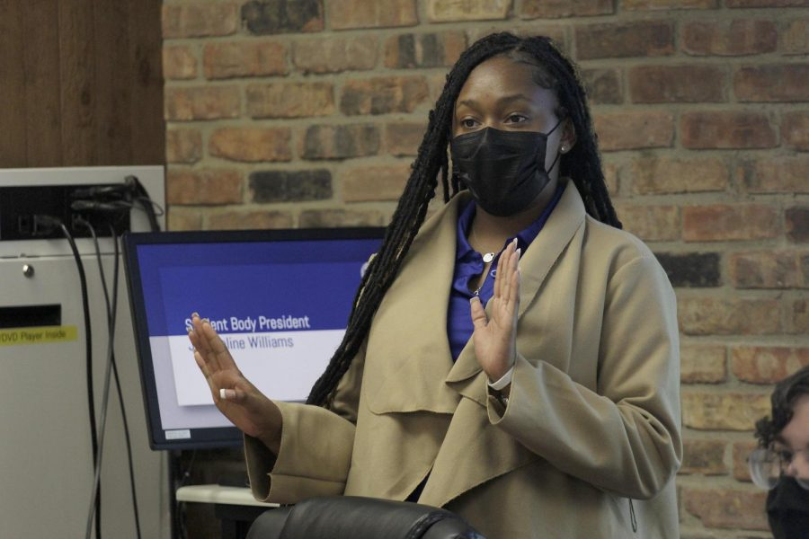 Student Government President Jacqueline Williams gives a statement about the recent homecoming campaign rumors and how she isn't involved at the Student Government meeting Wednesday night.
