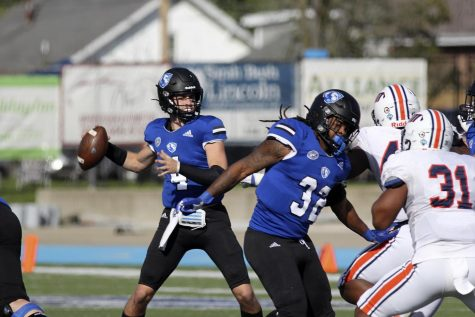 Eastern quarterback Otto Kuhns (left) drops back to pass in the Panthers game against Tennessee-Martin on Oct. 16 at OBrien Field. Kuhns threw for a touchdown and ran for another in the game, which Eastern lost 28-17.
