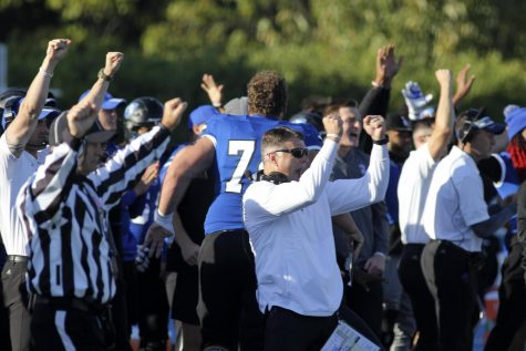 Eastern head coach Adam Cushing (center) and the rest of the sideline celebrate a stop in the Panthers game against Tennessee-Martin at OBrien Field on Saturday. Eastern lost the game 28-17 to the Skyhawks.