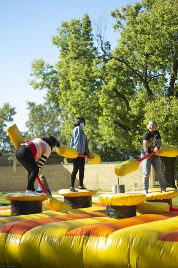 Amairany Bueno, a freshman management major, Evodie Tshipamba, an electrical engineering major, and Diana Maggi, a freshman biology major, compete against each other in inflatable jousting during the Kick-Off in the Library Quad.