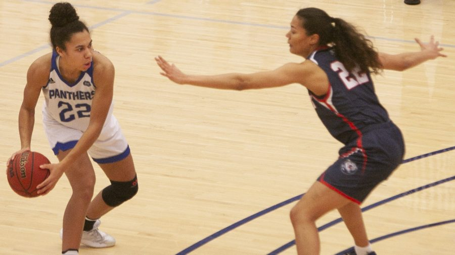Eastern guard Lariah Washington looks to pass the ball into the paint in a game against Belmont Feb. 4 in Lantz Arena. Washington led the team with 23 points in the game, which Eastern lost 77-75.