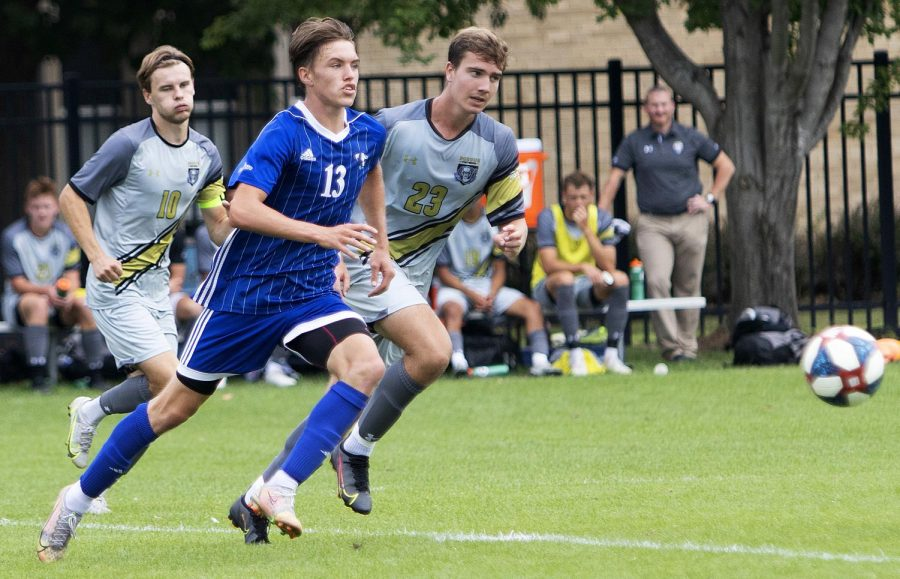 Eastern midfielder Chad Hamler tries to beat two opponents to the ball in Easterns match against Purdue Fort Wayne on Sept. 3 at Lakeside Field. Eastern lost the match 1-0.