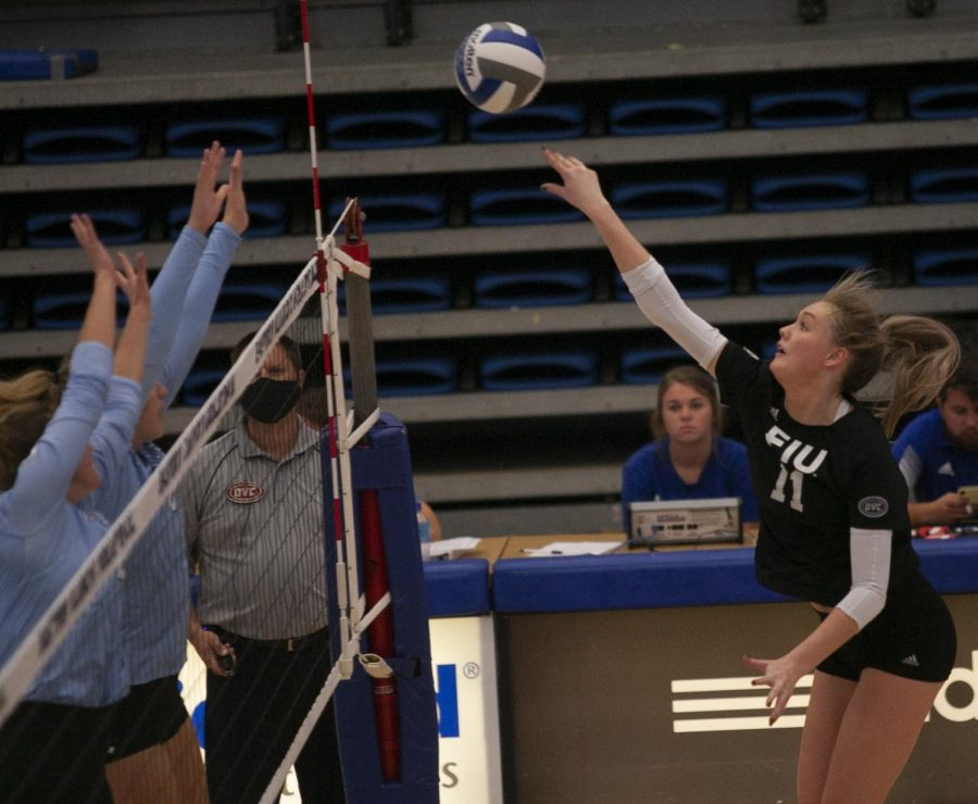 Eastern outside hitter Kaitlyn Flynn follows through on a kill attempt in a match against Indiana State on Sept. 19 in Lantz Arena. Flynn had 10 kills and 10 digs in the match, which Eastern lost 3-1.