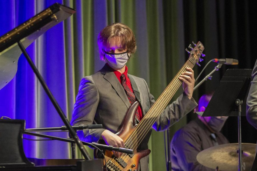 Bass player, Jacob Pope, a senior computational physics major, plays in the Johnston Quintet at the Jazz Combos performance Thursday, Oct. 21, in the Doudna Fine Arts Center Black Box Theatre.