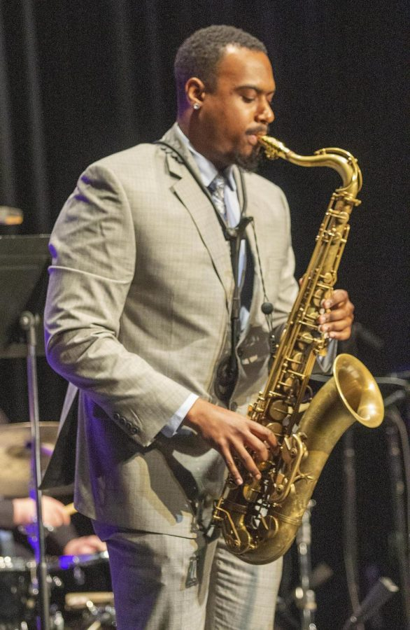 Tenor saxophone player, Kyle Huddleston, a graduate student studying music, plays in the Johnston Quintet at the Jazz Combos performance Thursday, Oct. 21, in the Doudna Fine Arts Center Black Box Theatre.