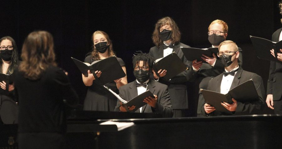 """Member of the ensembles watch their director, Kellie Clark, give instruction for vocal cues. The concert took place Sunday afternoon and was called """"Through Darkness to Light."""" Clark said the selection of music was one of the hardest parts for this concert and that she wanted it to reflect the recent pandemic."""