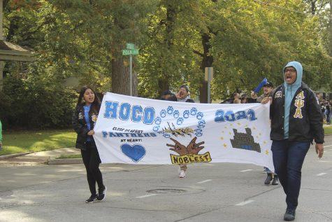 Members of Alpha Psi Lambda National Incorporated march in the homecoming parade Saturday morning.