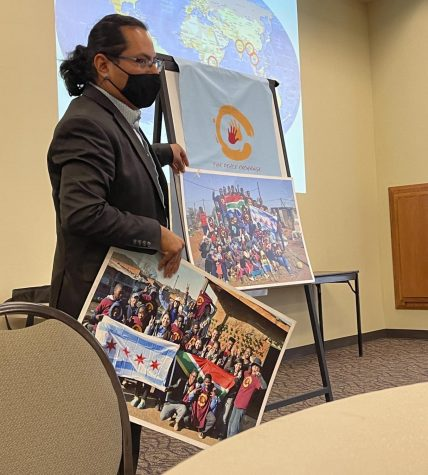 Henry Cervantes, program manager at The Peace Exchange, gives a presentation on nonviolence and social change at the Charleston Carnegie Library, Friday afternoon.