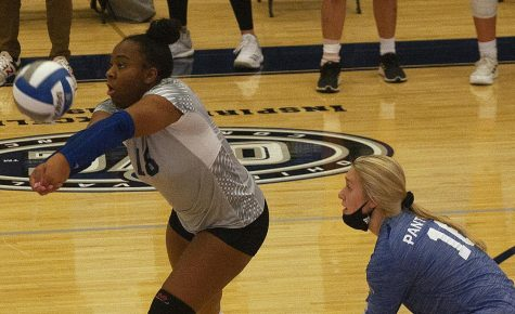 Eastern freshman outside hitter TaKenya Stafford (left) receives a serve in a match against Morehead State on Oct. 22 in Lantz Arena. Stafford had 6 kills in the match, a 3-0 loss for Eastern.